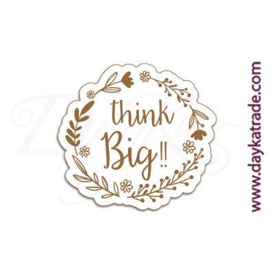 """Etiqueta de tablero lacado blanco con mensaje grabado """"Think big""""."""