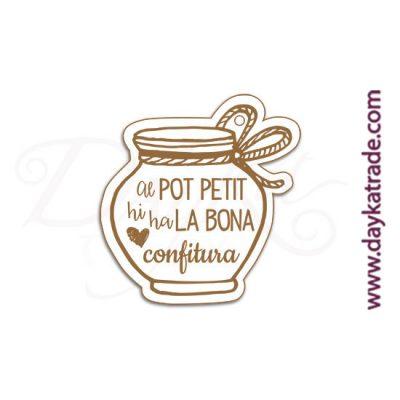 "Mensaje de tablero lacado blanco con mensaje grabado ""Al pot petit hi ha la bona""."