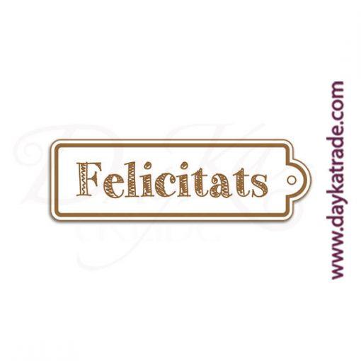"""Etiqueta de tablero lacado blanco con mensaje grabado en catalán """"Felicitats""""."""