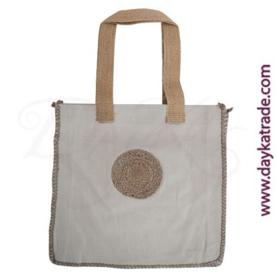 Cream colored shopper bag with string circle.