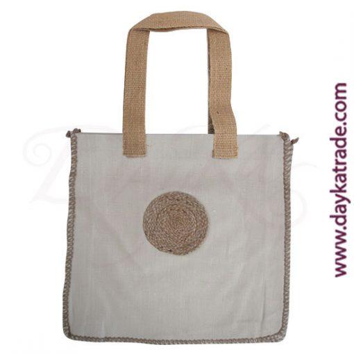 Bolso shopper color crema con círculo de cuerda.