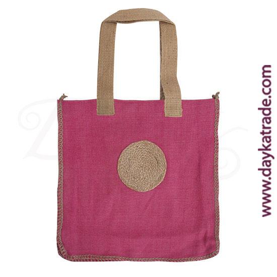 Bolso shopper color fresa con círculo de cuerda.